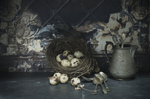 Easter nest of quail eggs, silver spoons and jar - ASF005954