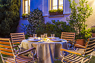 Laid table in garden in the evening - WDF003693