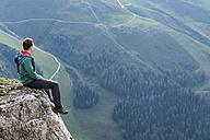Austria, Tyrol, hiker sitting on rock - MKFF000304