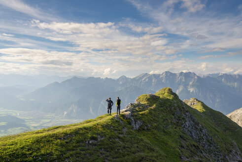Austria, Tyrol, hiker looking to valley - MKFF000307
