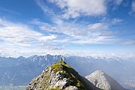 Austria, Tyrol, hiker standing on peak - MKFF000310