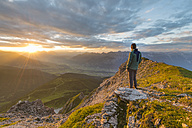Austria, Tyrol, hiker enjoying sunset - MKFF000316