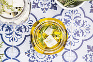 Glass of diced sheep cheese pickled in olive oil, thyme, garlic, pepper and rosmary - LVF005142