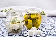 Glass of diced sheep cheese pickled in olive oil, thyme, garlic, pepper and rosmary - LVF005145
