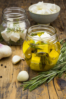 Glass of diced sheep cheese pickled in olive oil, thyme, garlic, pepper and rosmary - LVF005151