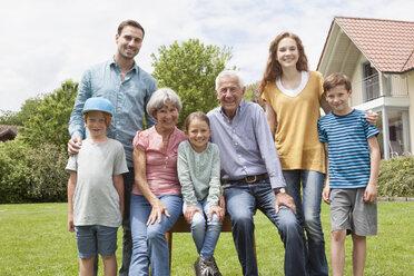 Portrait of happy extended family in garden - RBF004757