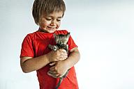 Portrait of smiling little boy holding kitten - VABF000720