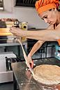 Woman preparing pizza dough - MGOF002086