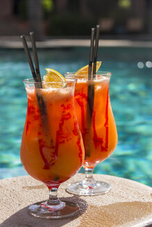 Two glasses of fruity cocktail - JUNF000538