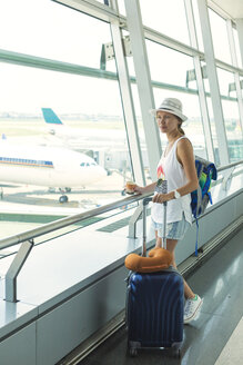 Vietnam, Ho Chi Minh city, young woman in airport - KNTF000430