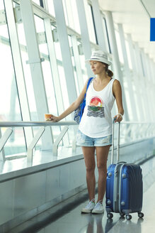 Vietnam, Ho Chi Minh city, young woman in airport - KNTF000433