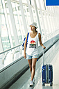 Vietnam, Ho Chi Minh city, young woman in airport - KNTF000436