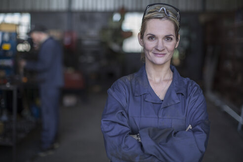 Portrait of confident female mechanic in workshop - ZEF009313