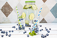 Glasses of infused water with lime, blueberries and mint - LVF005173
