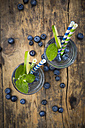 Glasses of infused water with lime, blueberries and mint - LVF005179