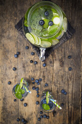 Glass of infused water with lime, blueberries and mint - LVF005182