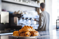 Croissants on plate on counter of a cafe - DIGF000781