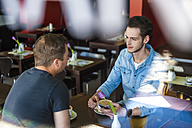 To men socializing in a cafe - DIGF000787