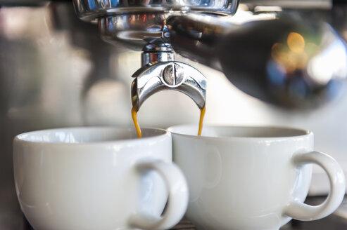 Coffee machine preparing two cups of coffee - DIGF000793
