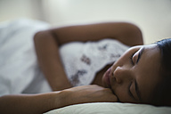 Young woman sleeping in bed - EBSF001542