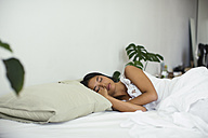 Young woman sleeping in bed - EBSF001545