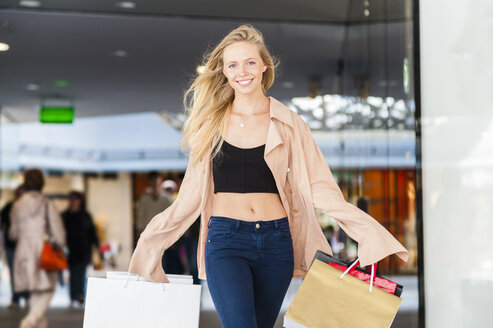 Young woman on a shopping spree - DIGF000821