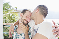 Tender kiss of a gay couple in love - MRAF000109