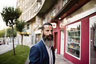 Portrait of businessman with full beard - JASF001025