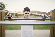 Portrait of a young man, ready to train on metall bars - RAEF001322