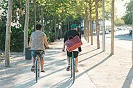 Two men riding bike - SKCF000126