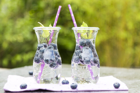 Two carafes of infused water with blueberries and mint - SARF002827