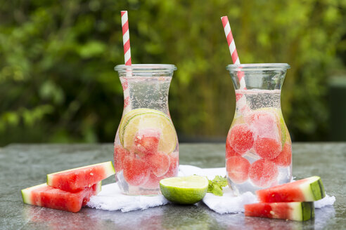 Two carafes of infused water with watermelon and lime - SARF002830