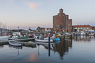 Germany, Schleswig-Holstein, Eckernfoerde, fishing harbour and round silo - KEBF000389