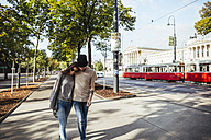 Austria, Vienna, young couple strolling on ring road - AIF000365