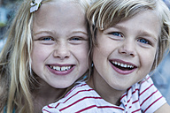 Portrait of smiling little boy and his sister head to head - TCF005055