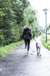 Young woman jogging with dog - REAF000133
