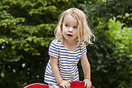 Portrait of blond little girl on playground - TCF005066