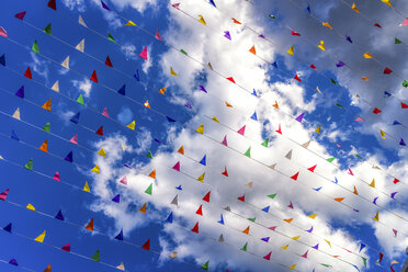 Colored flags against a blue sky - SMAF000521