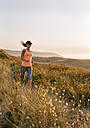 Asturias, Spain, Aviles, young athlete woman running along a coastal path in the evening - MGOF002138