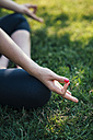 Young woman meditation outside in the park, hand, close-up, mudra - BZF000333