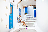 Greece, Amorgos island, young man using a cell phone - GEMF000948