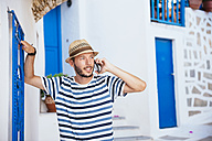 Greece, Amorgos island, young man talking on cell phone - GEMF000951
