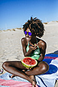 Happy young woman with watermelon on the beach - KIJF000629