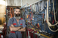 Portrait of confident man in workshop - JASF001054