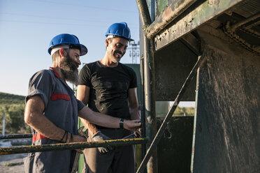 Two mechanics working outdoors - JASF001090