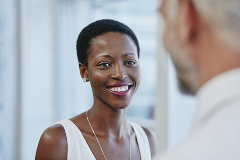 Smiling businesswoman looking at businessman - RORF000217