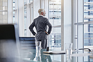 Businessman looking out of the window - RORF000226