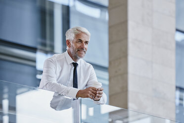 Businessman relaxing with coffee - RORF000244