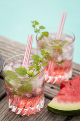 Fresh mineral water with watermelon, sirup and ice in glasses - JUNF000558