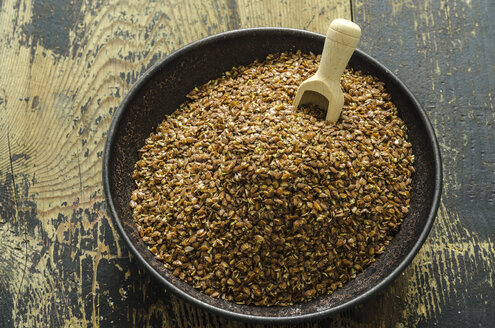 Bowl of linseed with wooden shovel - ODF001439